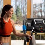 HZ19_LIFESTYLE_7_0AT-female_treadmill_resting-arm-looking-left_back_lores-scaled