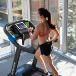 HZ19_LIFESTYLE_7_0AT-female_treadmill_running-black-shorts_side-hi-angle_lores-scaled