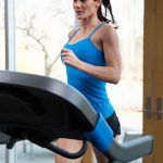 HZ19_LIFESTYLE_7_0AT-female_treadmill_running-blue-shirt-left-arm-leading_front-angle_lores-scaled