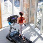 HZ19_LIFESTYLE_7_0AT-female_treadmill_running_cropped-back-hi-angle_lores-scaled